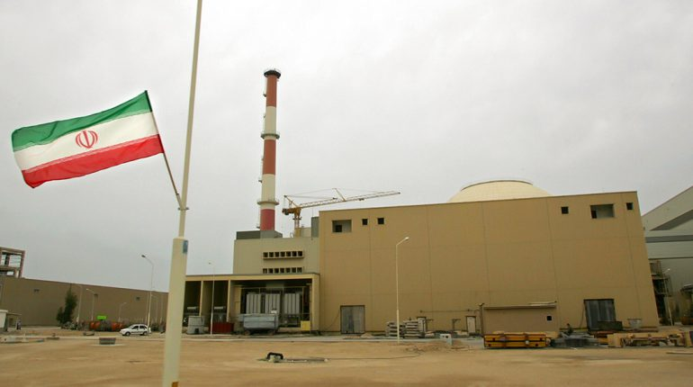 (FILES) An Iranian flag flies outside the building housing the reactor of the Bushehr nuclear power plant, in the Iranian port town of Bushehr, 1200 Kms south of Tehran, 03 April 2007.  Russia's Atomstroiexport corporation said 17 December 2007 that it had begun deliveries of nuclear fuel for Iran's first atomic power station at Bushehr. AFP PHOTO/BEHROUZ MEHRI (Photo credit should read BEHROUZ MEHRI/AFP/Getty Images)